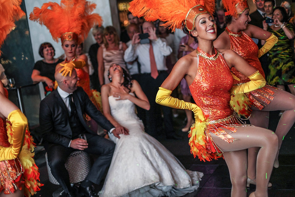 Brazilian dancers for the entertainment at the wedding reception at River's Edge Events wedding venue. Beautiful wedding photography by popular Sydney wedding photographer, Grant Hoskinson Photography.