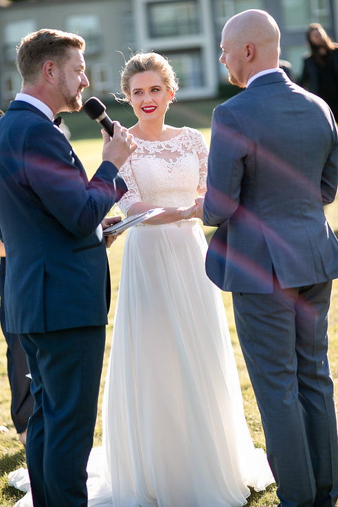 Bride and groom saying vows at outdoor wedding ceremony at Gibraltar Hotel, Bowral. Wedding photography by best sydney wedding photographer, Grant Hoskinson Photography.