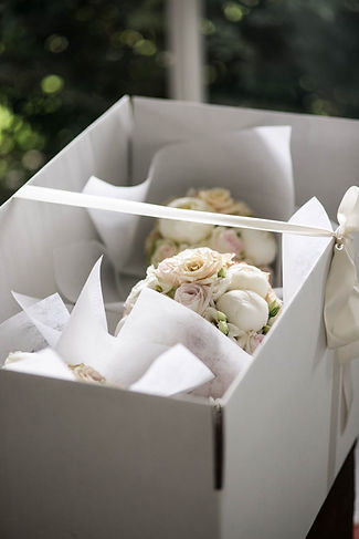Bride's bouquet and bridesmaids bouquets delivered in a box. Wed