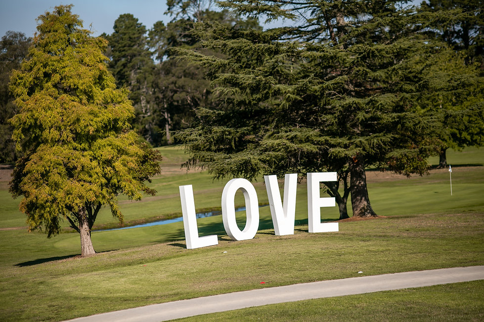 Love sign at the ceremony site at Gibraltar Hotel, Bowral. Wedding photography by best sydney wedding photographer, Grant Hoskinson Photography.