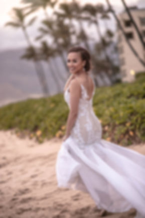 Bride on the beach outside Sugar Beach Events in Maui. Hawaii. Photography by Sydney's best wedding photographer, Grant Hoskinson Photography.