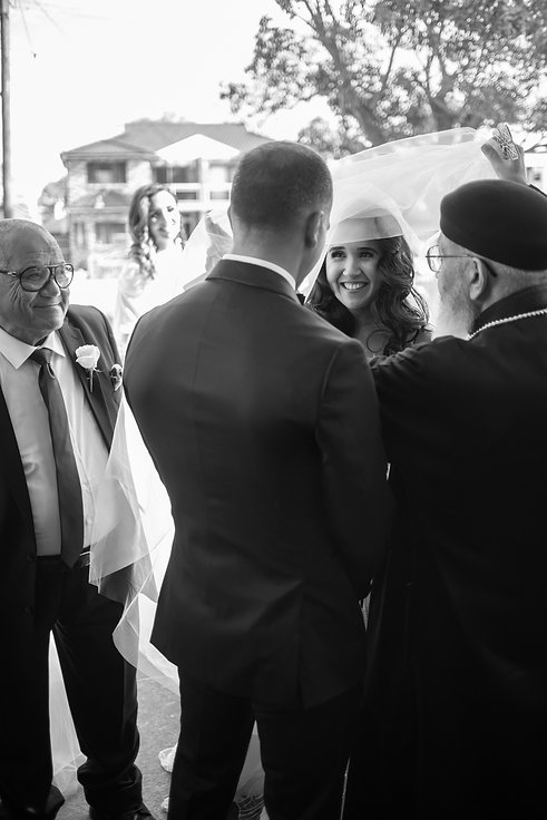 Wedding ceremony at St Mary and St Mina Orthodox Coptic Church, Bexley. Wedding photography by best Sydney wedding photographer, Grant Hoskinson Photography. Bride's gown by Steven Khalil. Wedding Reception at Doltone House Jones Bay Wharf.
