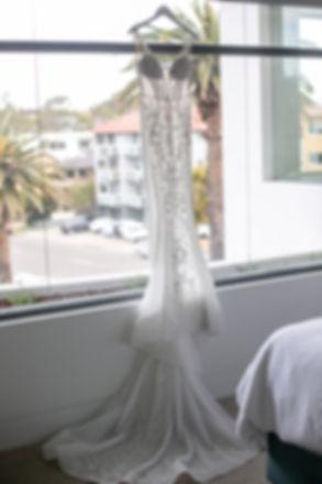 Bride's wedding dress hanging. Wedding photography by best sydney wedding photographer, Grant Hoskinson Photography.
