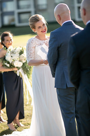 Bride and groom saying vows at outdoor ceremony at Gibraltar Hotel, Bowral. Wedding photography by best sydney wedding photographer, Grant Hoskinson Photography.