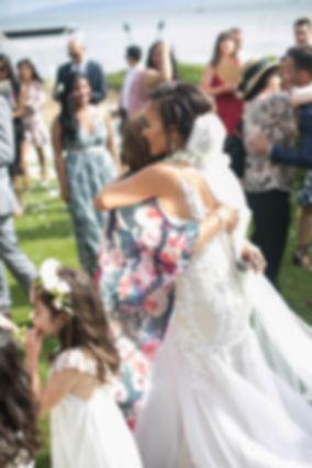Sydney wedding photographer. Grant Hoskinson Photography. Bride in wedding dress hugging friend.