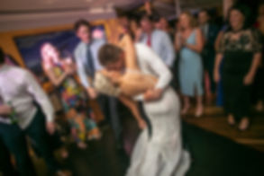 Bride and groom dancing at the wedding reception venue at Catalina, Rose Bay. Wedding photography by best sydney wedding photographer, Grant Hoskinson Photography.