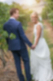 Beautiful wedding photography by Sydney wedding photographer, Grant Hoskinson. Wedding photographers in Sydney. Bride and groom amongst the vines at Stones of the Yarra Valley.