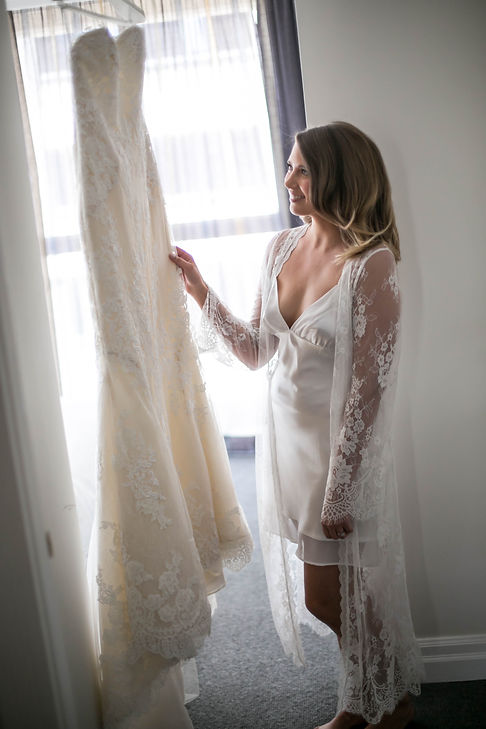 Beautiful wedding photography by best sydney wedding photographer, Grant Hoskinson Photography. Bride looking at wedding dress.