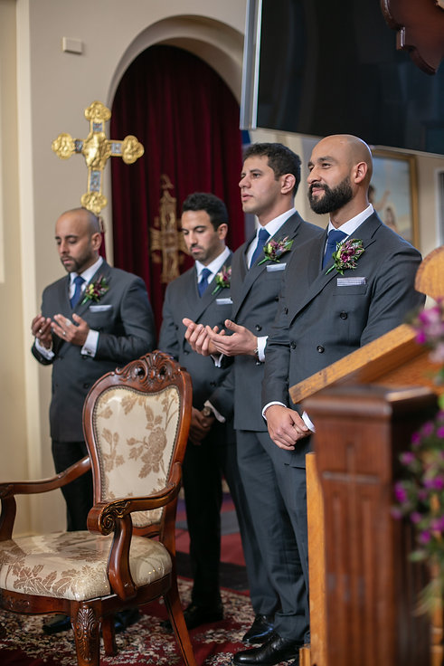 Groomsmen during the Egyptian Coptic wedding ceremony. St Mary and St Merkorious Coptic Orthodox church. Photography by best Sydney wedding photographer Grant Hoskinson Photography.
