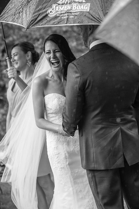 Beautiful wedding photography by popular wedding photographer, Grant Hoskinson Photography. Bride laughing during the wedding ceremony.Groom with groomsmen.  Royal Botanic Gardens, Melbourne.