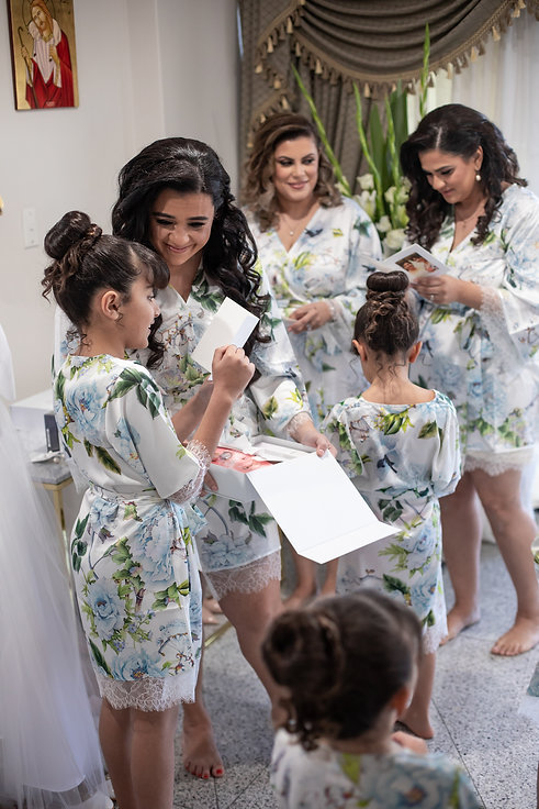 Bridesmaids in dressing gowns. Bride's shoes by Valentino. Bride's bouquet by Sydney wedding flowers. Wedding photography by best Sydney wedding photographer, Grant Hoskinson Photography. Bride's gown by Steven Khalil. Wedding Reception at Doltone House Jones Bay Wharf.