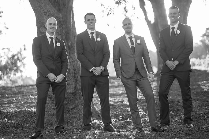 Groom with groomsmen with bridal party on location at at Gibraltar Hotel, Bowral. Wedding photography by best sydney wedding photographer, Grant Hoskinson Photography.