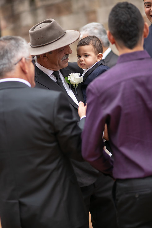 Candid guest shots after wedding ceremony at Hyde Park Barracks, Sydney. Wedding photography by best wedding photographer sydney, Grant Hoskinson Photography.