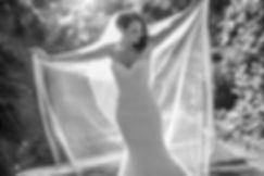 Beautiful wedding photography by Sydney wedding photographer, Grant Hoskinson. Wedding photographers in Sydney. Bride holding veil up in royal Botanic Gardens, Melbourne.