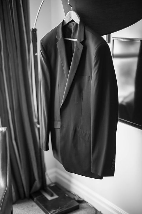 Beautiful wedding photography by best Sydney wedding photographer, Grant Hoskinson Photography. Groom's suit jacket hanging