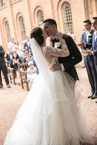 Bride and groom during wedding ceremony at Hyde Park Barracks. Kiss the bride. Wedding photgraphy by Sydney wedding photographer Grant Hoskinson Photography.