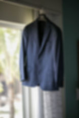 Sydney wedding photographer. Grant Hoskinson Photography. Grooms suit jacket hanging in window. Suit by MJ Bale.