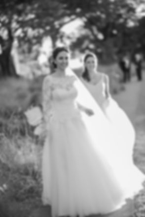 Bride and bridesmaid during location photos at Centennial Park. Wedding photography by best sydney wedding photographer, Grant Hoskinson Photography.