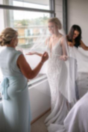 Bride putting the veil on. Wedding photography by best sydney wedding photographer, Grant Hoskinson Photography.