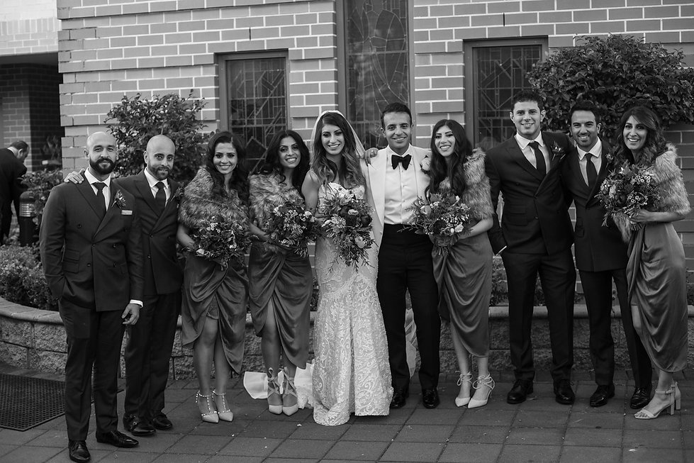 Bride and groom with bridal party after the wedding ceremony. Bride and groom during Egyptian Coptic wedding ceremony. St Mary and St Merkorious Coptic Orthodox church. Photography by best Sydney wedding photographer Grant Hoskinson Photography.