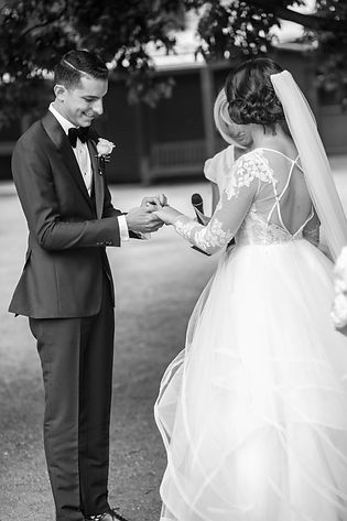 Bride and groom during exchange of rings during wedding ceremony at Hyde Park Barracks. Wedding photgraphy by Sydney wedding photographer Grant Hoskinson Photography.