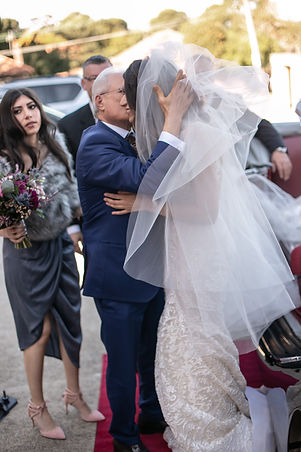 Father of the bride kisses the bride before the wedding ceremony. St Mary and St Merkorious Coptic Orthodox church. Photography by best Sydney wedding photographer Grant Hoskinson Photography.