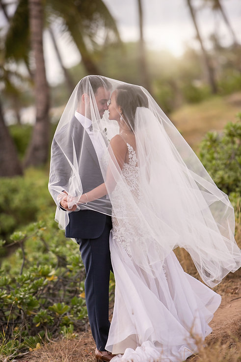 Sydney wedding photographer. Grant Hoskinson Photography. Bride and groom on location in Maui, Hawaii. Under the veil. Romantic wedding photograph.