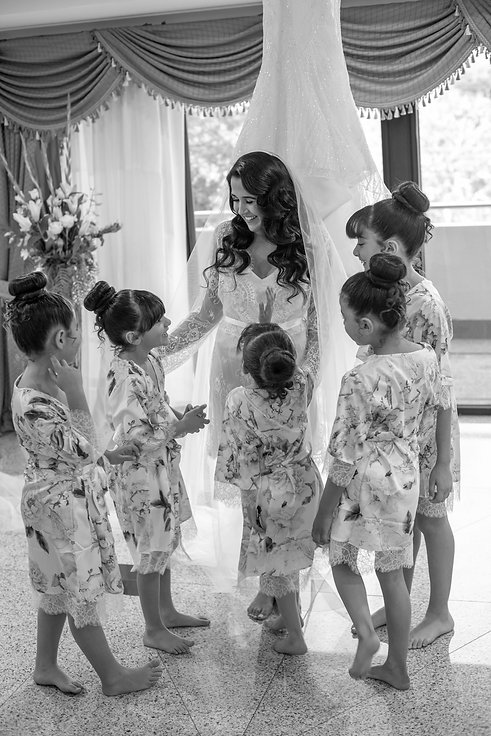 Flowergirls. Bride's shoes by Valentino. Bride's bouquet by Sydney wedding flowers. Wedding photography by best Sydney wedding photographer, Grant Hoskinson Photography. Bride's gown by Steven Khalil. Wedding Reception at Doltone House Jones Bay Wharf.