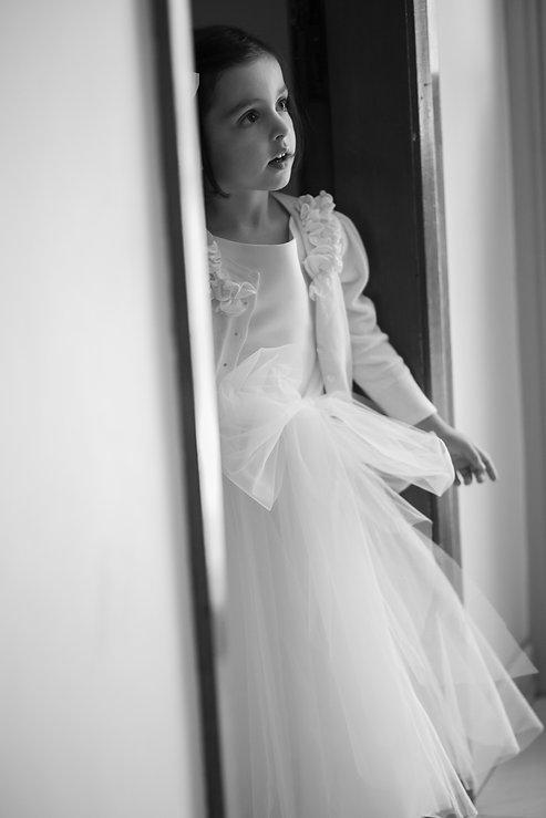 Flowergirl watching bride getting ready. Wedding photography by best sydney wedding photographer, Grant Hoskinson Photography.
