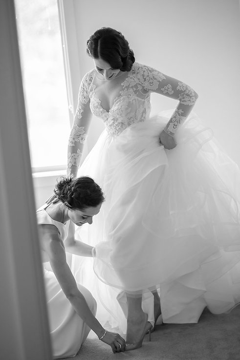 Bride putting her wedding shoes on. Wedding photography by best sydney wedding photographer, Grant Hoskinson Photography.