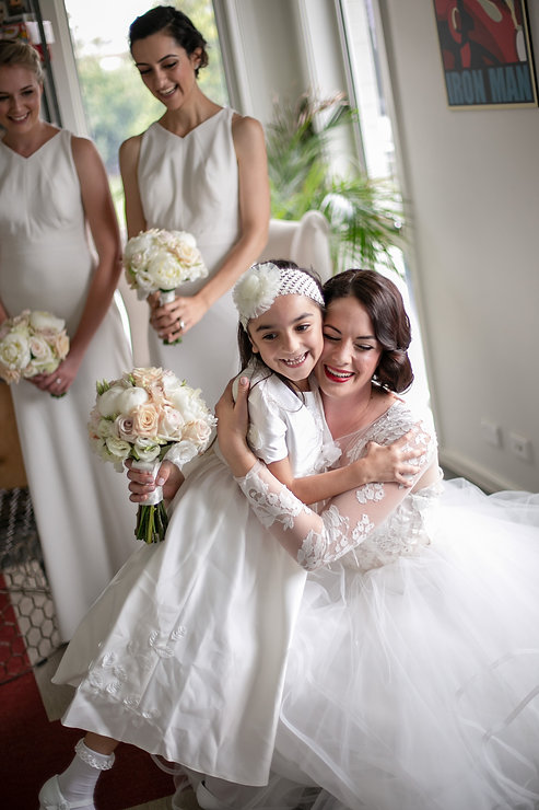 Bride with the flowergirl. Wedding photography by best sydney wedding photographer, Grant Hoskinson Photography.