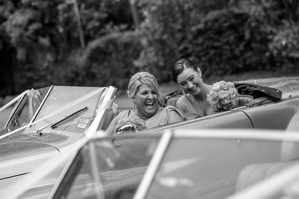 Beautiful wedding photography by popular wedding photographer, Grant Hoskinson Photography. Bridesmaids in weddin car. Groom with groomsmen.  Royal Botanic Gardens, Melbourne.