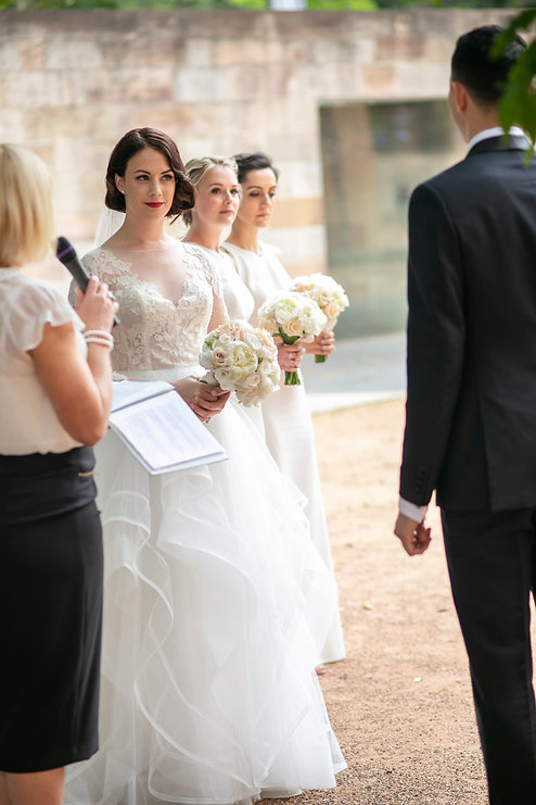 Bride and groom during wedding ceremony at Hyde Park Barracks. Wedding photography by best sydney wedding photographer, Grant Hoskinson Photography.