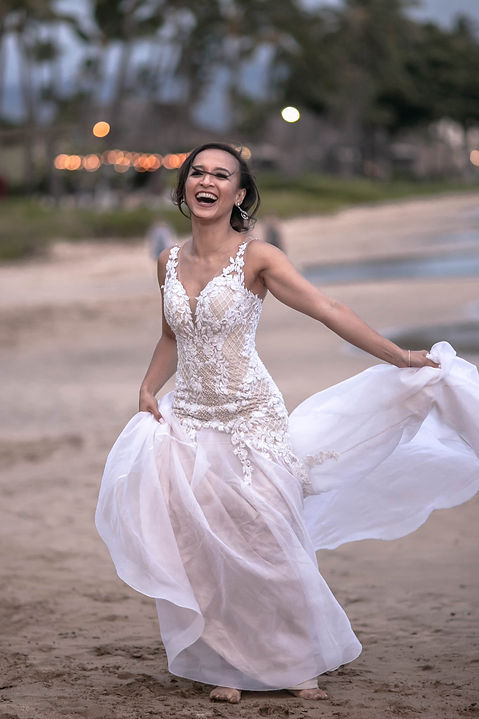 Bride dancing on the beach in Maui, Hawaii. Outside Sugar Beach Events in Maui, Hawaii. Destination wedding photography by Sydney wedding photographer Grant Hoskinson Photography.
