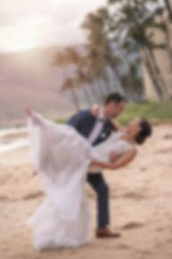Bride and groom on the beach. Sugar Beach Events. Maui, Hawaii.