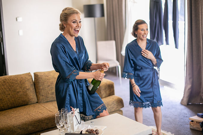 Bridesmaids pouring champagne at Gibraltar Hotel, Bowral. Wedding photography by best sydney wedding photographer, Grant Hoskinson Photography.