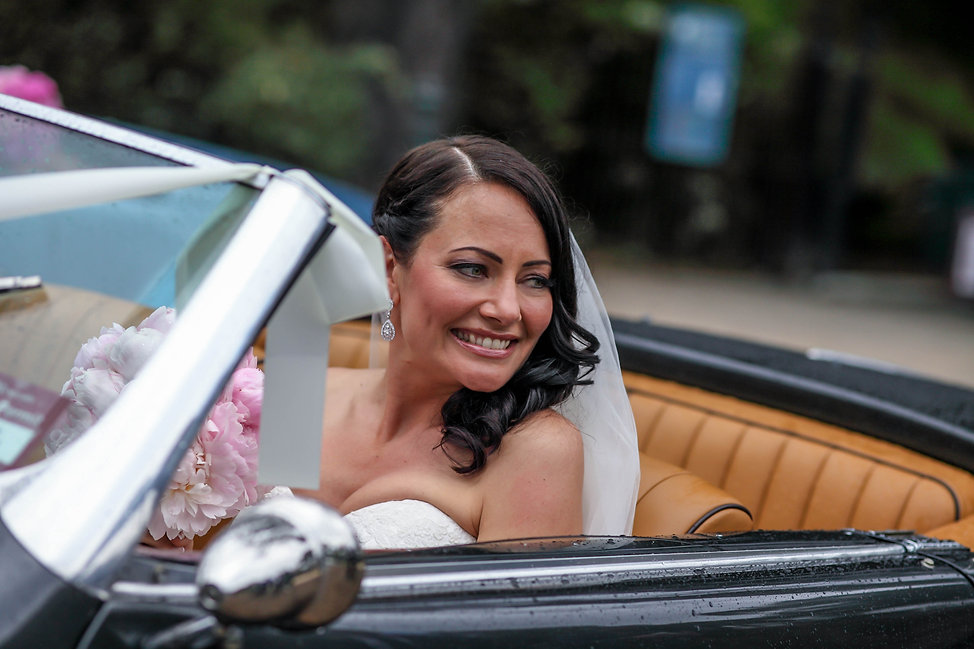 Beautiful wedding photography by popular wedding photographer, Grant Hoskinson Photography. Bride in bridal car. Groom with groomsmen.  Royal Botanic Gardens, Melbourne.