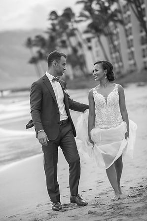 Bride and groom on the beach. Sugar Beach Events. Maui, Hawaii.