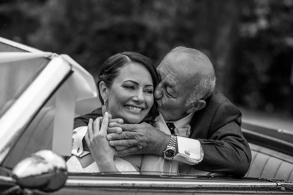 Beautiful wedding photography by popular wedding photographer, Grant Hoskinson Photography. Father of the bride and bride in bridal car.Groom with groomsmen.  Royal Botanic Gardens, Melbourne.