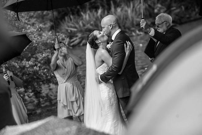 Beautiful wedding photography by popular wedding photographer, Grant Hoskinson Photography. Kiss the bride. Wedding photography. Groom with groomsmen.  Royal Botanic Gardens, Melbourne.