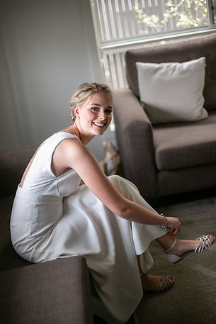 Bridesmaid putting her shoes on. Wedding Dress. Wedding photography by best sydney wedding photographer, Grant Hoskinson Photography.