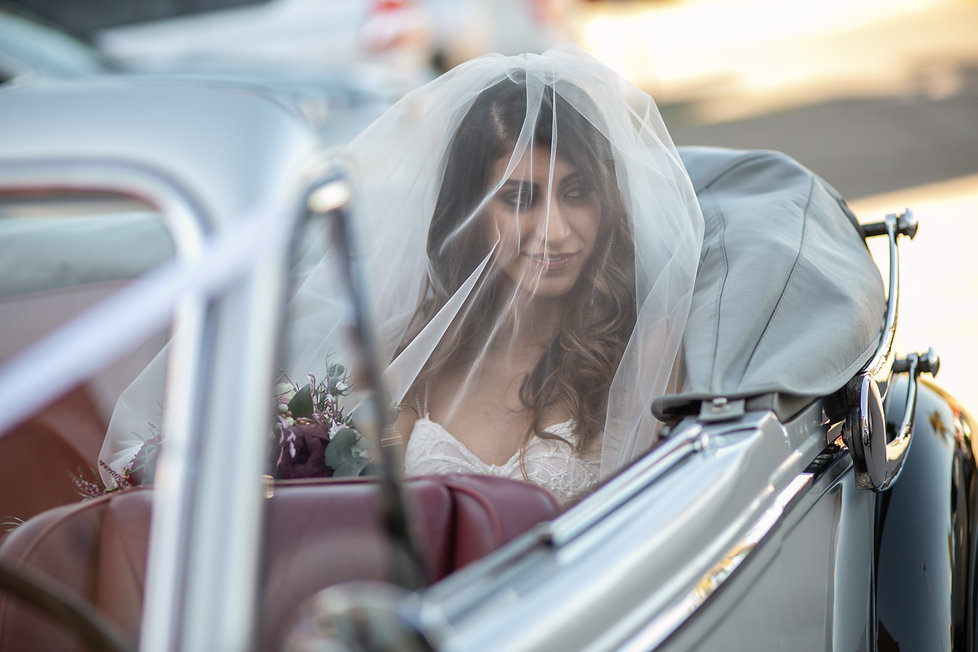Bride in wedding car at the church before the ceremony. St Mary and St Merkorious Coptic Orthodox church. Photography by best Sydney wedding photographer Grant Hoskinson Photography.