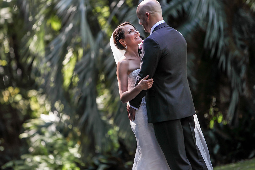 Bride and groom during a photo shoot in the Botanic Gardens, Melbourne. Beautiful wedding photography by popular Sydney wedding photographer, Grant Hoskinson Photographer.
