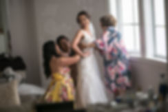 Sydney wedding photographer. Grant Hoskinson Photography. Bride putting dress on with bridesmaids and mother of the bride.