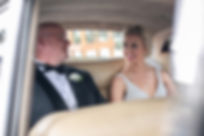 Bride with the father of the bride in the back of the wedding car. Wedding photography by best sydney wedding photographer, Grant Hoskinson Photography.