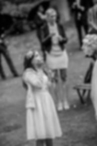 Beautiful wedding photography by popular wedding photographer, Grant Hoskinson Photography. Wedding guests blowing bubbles after the wedding ceremony.
