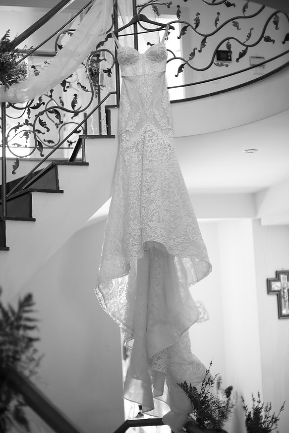 Bride's wedding dress hanging up. Photography by best Sydney wedding photographer Grant Hoskinson Photography.