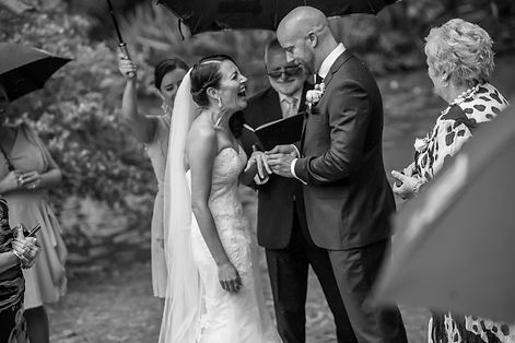 Beautiful wedding photography by popular wedding photographer, Grant Hoskinson Photography. Bride laughing during the wedding ceremony. Exchange of rings. Groom with groomsmen.  Royal Botanic Gardens, Melbourne.