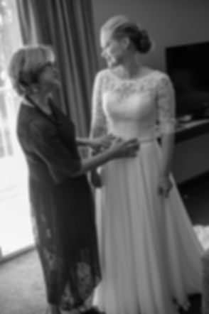 Mother of the bride and the bride getting ready at Gibraltar Hotel, Bowral. Wedding photography by best sydney wedding photographer, Grant Hoskinson Photography.