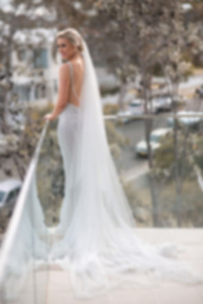 Full length portrait of the bride and the back of the wedding dress. Wedding photography by best sydney wedding photographer, Grant Hoskinson Photography.